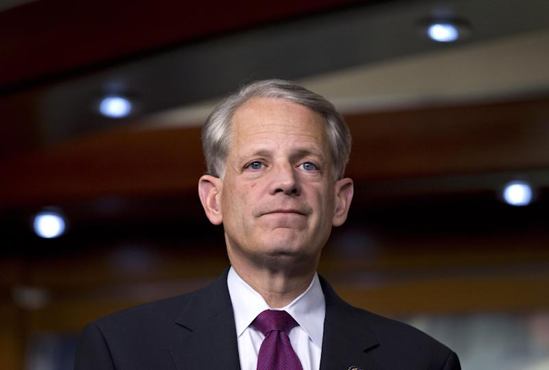 "FILE - In this Dec. 21, 2012, file photo, Rep. Steve Israel, D-N.Y., listens during a news conference at the Capitol in Washington. Having no immediate hope to overturn the U.S. Supreme Court's Roe v. Wade decision that legalized abortion nationwide, Republicans in capitols around the country have accelerated their push for legislative restrictions on the procedure, and Democrats say they'll make the GOP pay in coming elections. ""Defense workers are being furloughed, student loan interest rates have doubled, and these Republicans insist on a relentless pursuit of more restrictions on women's freedoms,"" said Israel, chairman of the Democrats' national congressional campaign for 2014. ""Swing voters are by their very nature moderate; they want solutions, not ideological warfare."" (AP Photo/J. Scott Applewhite, File)"
