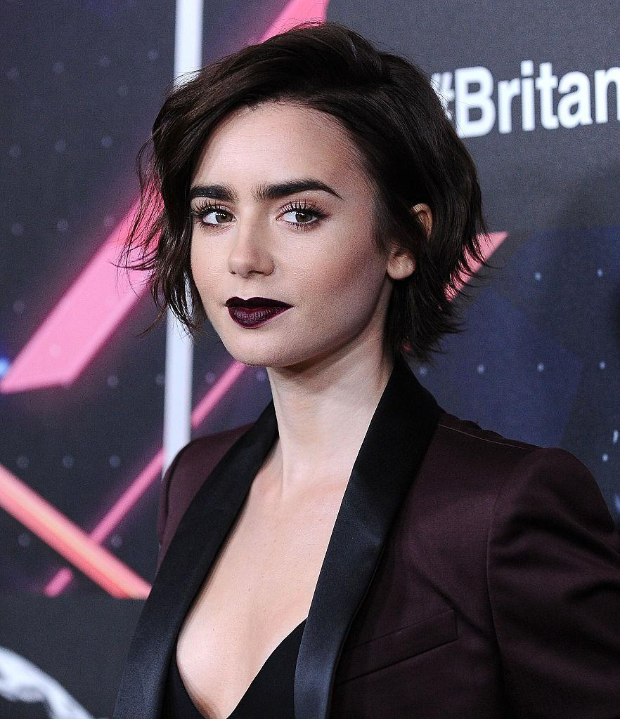 <p>Wine stained lips to go with her Merlot blazer at the 2015 British Academy Britannia Awards. <i>(Photo by Jason LaVeris/FilmMagic)</i><br></p>
