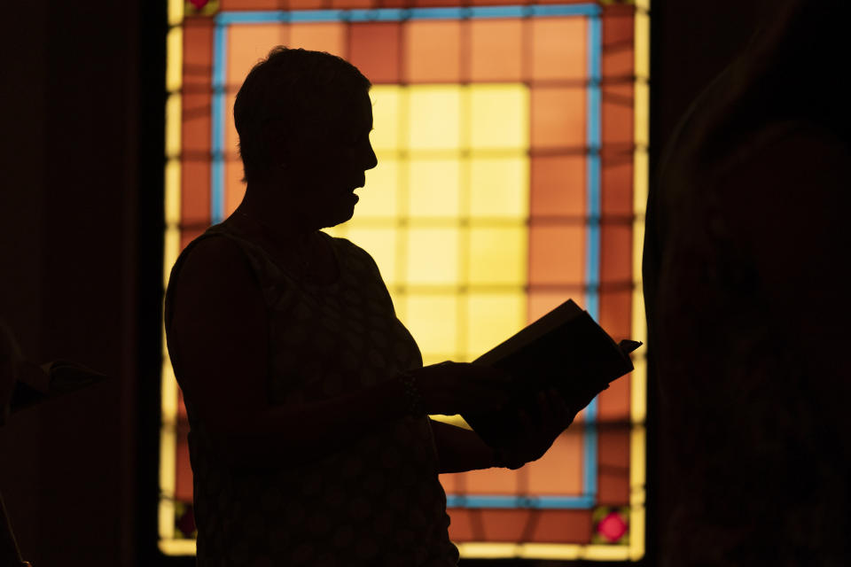 A member of Waldoboro United Methodist Church sings a hymn during a service, Sunday, June 20, 2021, in Waldoboro, Maine. The drop in attendance at the church, in part due to COVID-19, forced its closure. The last sermon was on June 27. (AP Photo/Robert F. Bukaty)