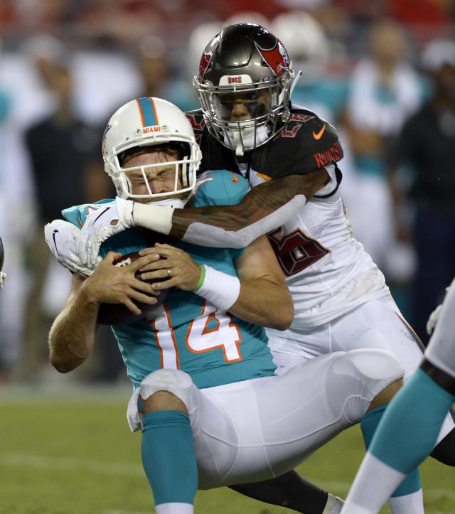 Tampa Bay Buccaneers defensive back Sean Murphy-Bunting (26) sacks Miami Dolphins quarterback Ryan Fitzpatrick (14) during the second half of an NFL preseason football game Friday, Aug. 16, 2019, in Tampa, Fla. (AP Photo/Jason Behnken)
