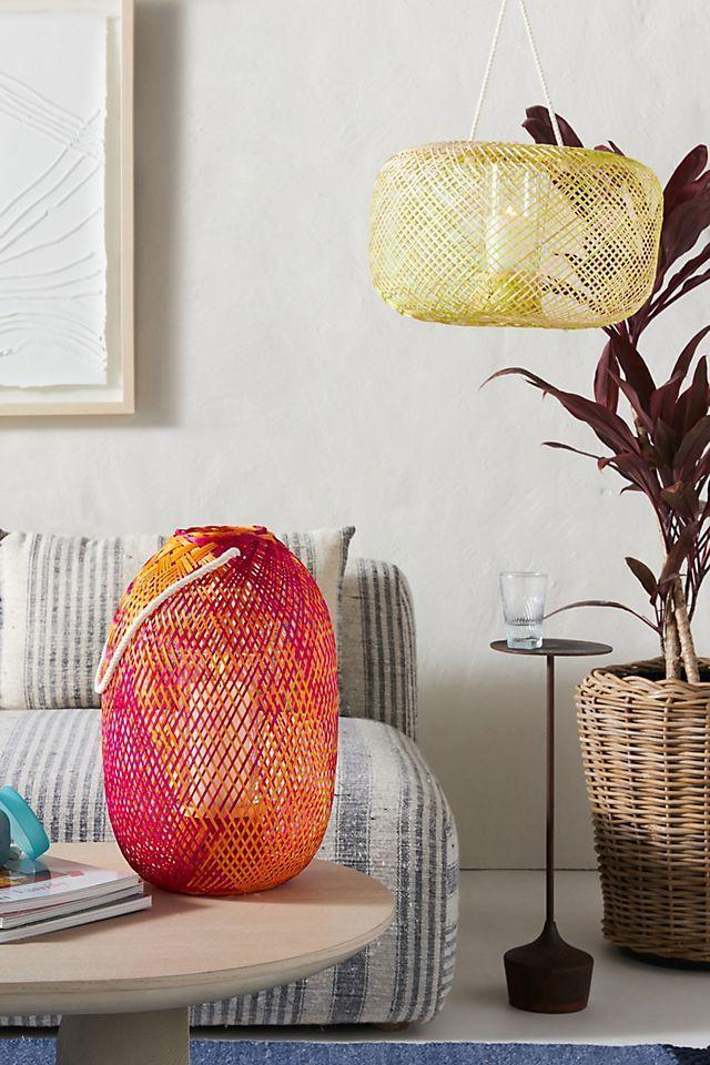 """<p><strong>Anthropologie</strong></p><p>anthropologie.com</p><p><strong>$54.40</strong></p><p><a href=""""https://go.redirectingat.com?id=74968X1596630&url=https%3A%2F%2Fwww.anthropologie.com%2Fshop%2Fines-bamboo-lantern&sref=https%3A%2F%2Fwww.thepioneerwoman.com%2Fhome-lifestyle%2Fgardening%2Fg36466053%2Fbackyard-lighting-ideas%2F"""" rel=""""nofollow noopener"""" target=""""_blank"""" data-ylk=""""slk:Shop Now"""" class=""""link rapid-noclick-resp"""">Shop Now</a></p><p>These vibrant lanterns look just as great sitting on the ground near a dining table as they do hanging from a porch or pergola. They're made of handwoven bamboo and can hold a pillar candle. </p>"""