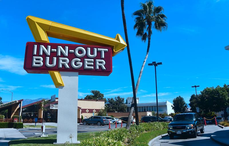 A driver pulls into the drive-thru lane at an In-N-Out Burger restaurant in Alhambra, California on August 30, 2018. - Califoria's Democratic Party Chairman, Eric Bauman, is calling for a boycott of the Irvine, CA based fast food chain after it donated $25,000 to help California Republicans in November. In addition to this week's donation, In-N-Out donated $30,000 to the GOP in 2017 and 2016. (Photo by Frederic J. BROWN / AFP) (Photo credit should read FREDERIC J. BROWN/AFP/Getty Images)