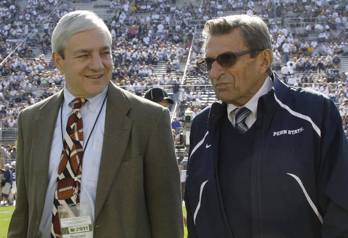 """FILE - In this Oct. 8, 2011, file photo Penn State president Graham Spanier, left, and head football coach Joe Paterno talk before an NCAA college football game against Iowa in State College, Pa. Spanier is accused of perjury, endangering children and other charges in the Jerry Sandusky molestation scandal. According to online court records charges were filed, Thursday, Nov. 1, 2012, against Penn State's ex-president and two other administrators in what prosecutors called """"a conspiracy of silence."""" (AP Photo/Gene Puskar, File)"""