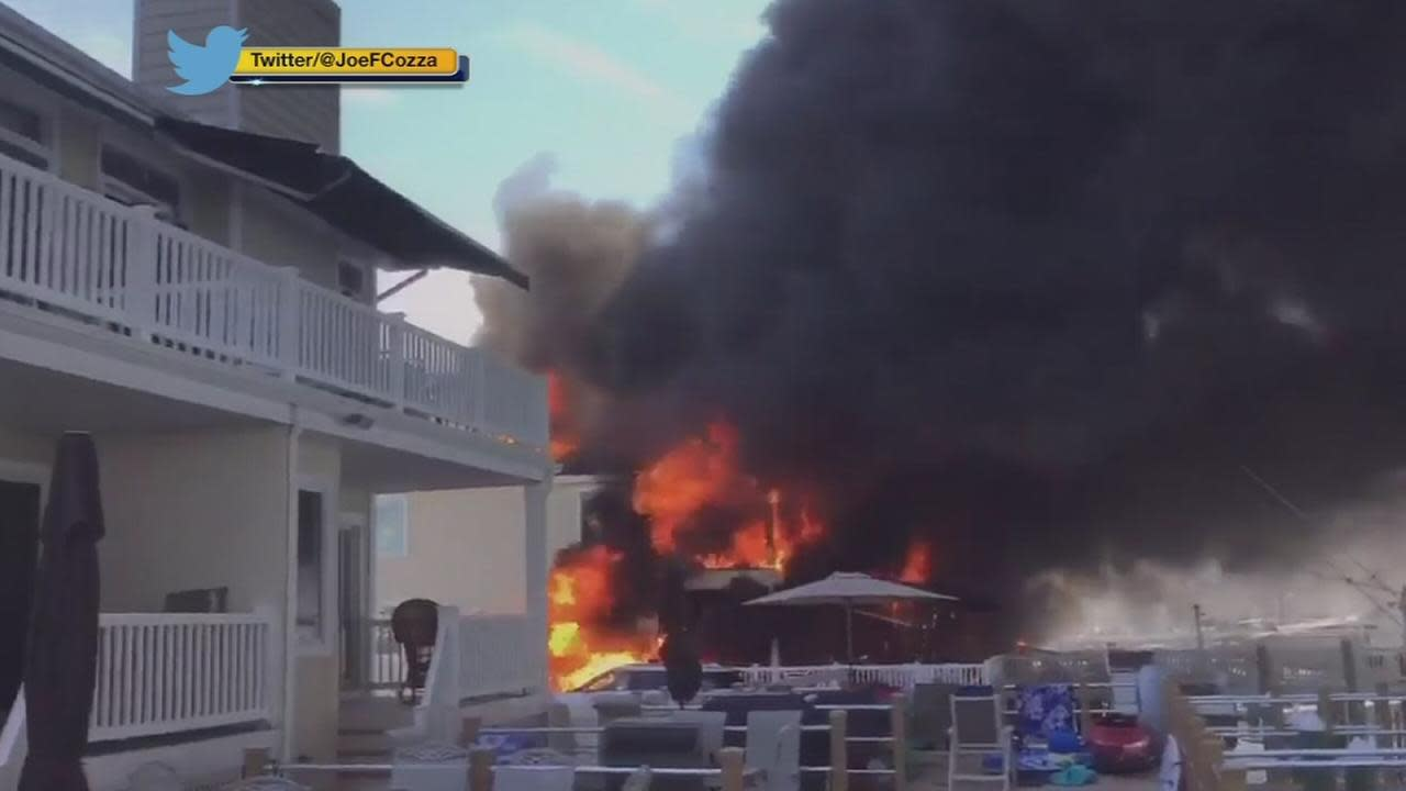 Fire crews spent Sunday on the scene of a massive house blaze in Wildwood Crest that sent thick black smoke billowing into the sky above the Jersey shore town