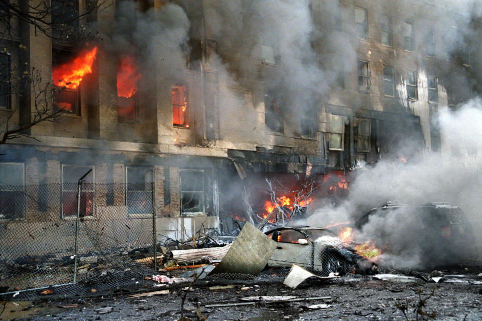 Flames and smoke pour from a building at the Pentagon in Washington on Tuesday, Sept. 11, 2001. (AP Photo/Will Morris)