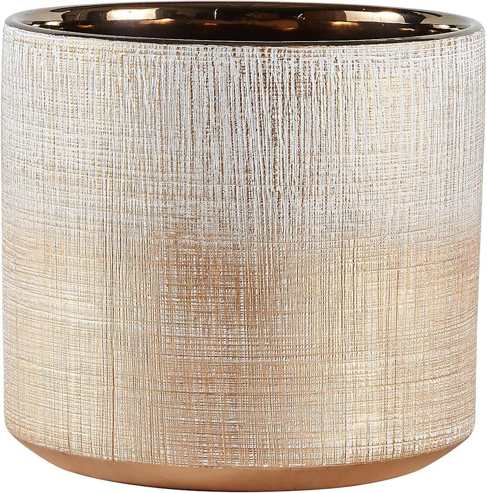 <p>Add a dash of glamour with this metallic <span>Rivet Rustic Stoneware Crosshatch Planter</span> ($24). It also comes in a variety of sizes and in bronze, silver, or coral. </p>