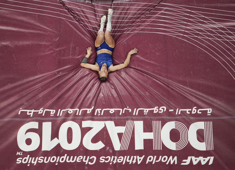 Anzhelika Sidorova, participating as a neutral athlete, lands after her final vault in the women's pole vault final at the World Athletics Championships in Doha, Qatar, Sunday, Sept. 29, 2019. Sidorova won the gold medal in the event. (AP Photo/Nick Didlick)