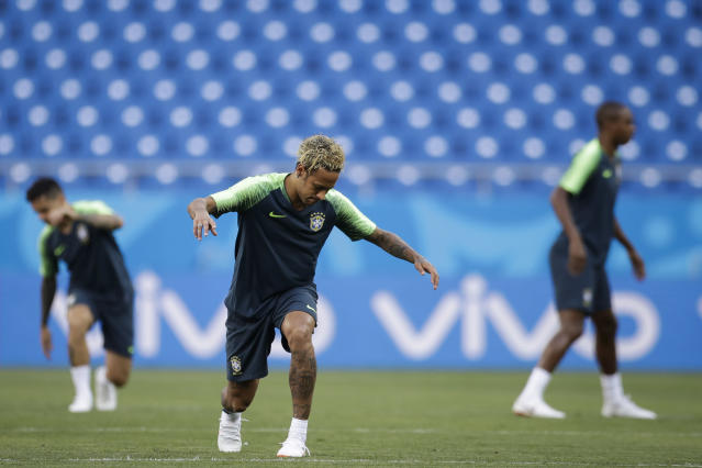 Brazil's Neymar stretches during Brazil's official training on the eve of the group E match between Brazil and Switzerland at the 2018 soccer World Cup in the Rostov Arena in Rostov-on-Don, Russia, Saturday, June 16, 2018. (AP Photo/Felipe Dana)