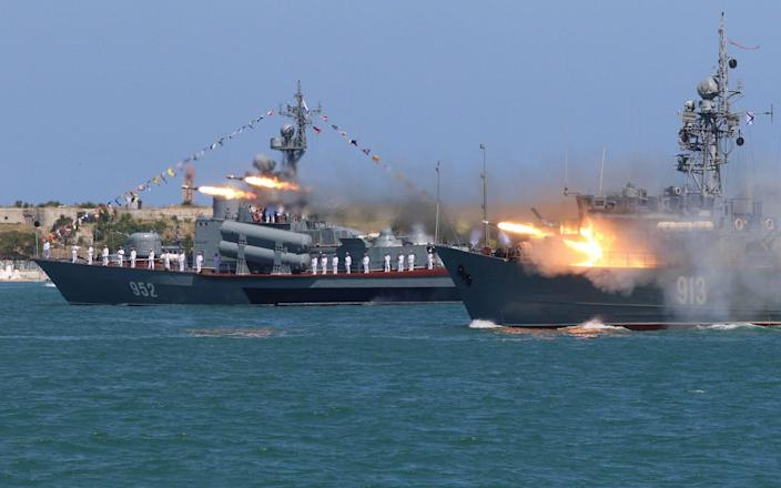 <span>A Russian Navy's minesweeper Kovrovets fires missiles</span> <span>Credit: REUTERS/Pavel Rebrov </span>