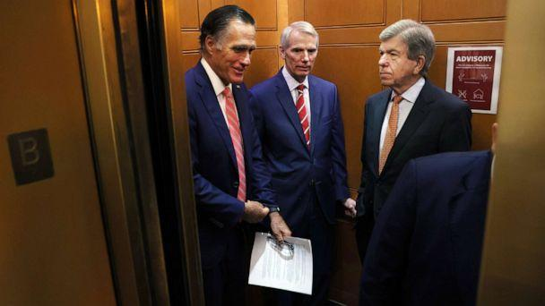 PHOTO: Sen. Mitt Romney, Sen. Rob Portman and Sen. Roy Blunt ride an elevator as they leave a bipartisan meeting on infrastructure at the U.S. Capitol on July 13, 2021, in Washington, D.C. (Kevin Dietsch/Getty Images)