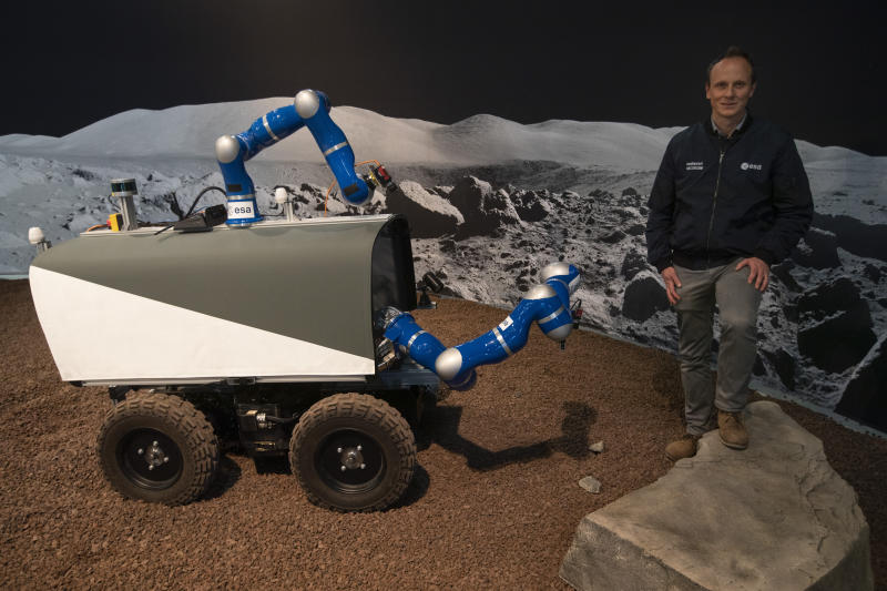 Kjetil Wormnes, automation and robotics system engineer, poses with the Space Rover after a training exercise of the European Space Agency, ESA, in Katwijk, near The Hague, Netherlands, Monday, Nov. 25, 2019. (AP Photo/Peter Dejong)