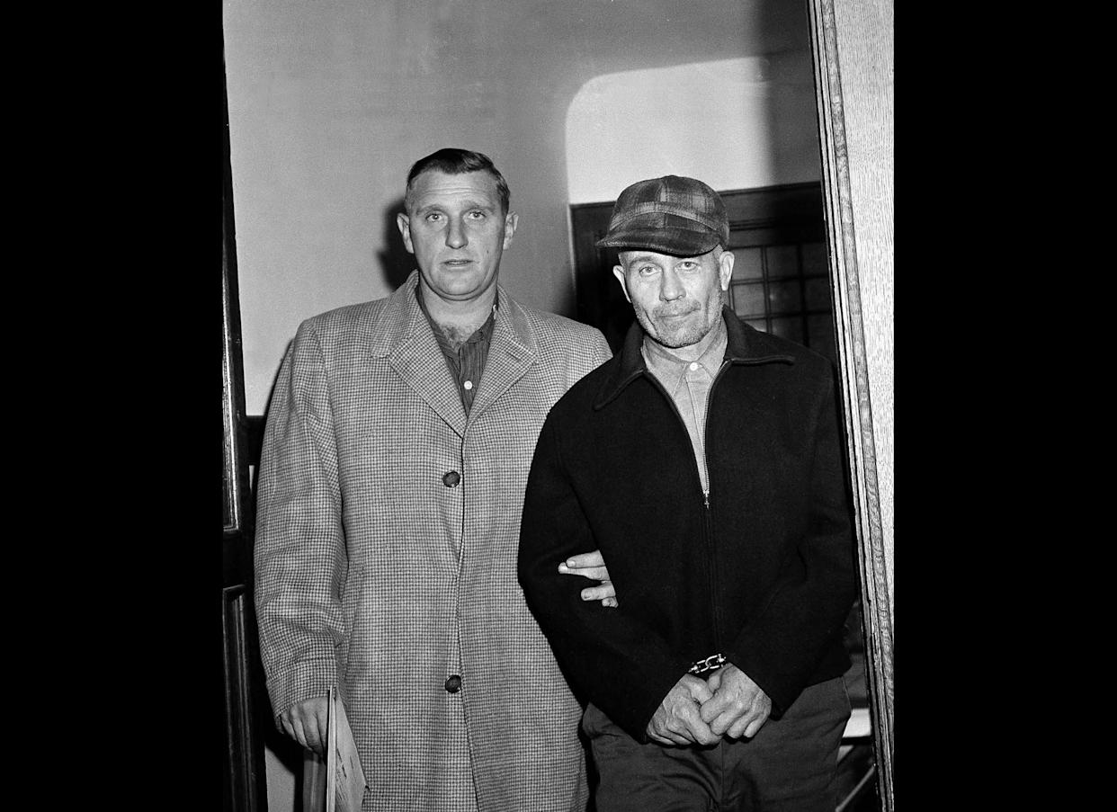 """Edward Gein, 51, of Plainfield, Wisc. enters Central State Hospital for the Criminally Insane Nov. 23,1957, in Milwaukee. Gein admitted to slaying two women and dismembering their bodies as well as robbing graves. Gein flayed the bodies and used human skin and other body parts to decorate furniture and clothing in his decrepit farmhouse. His twisted tale was the inspiration for murders in movies like Buffalo Bill from """"The Silence of the Lambs."""""""