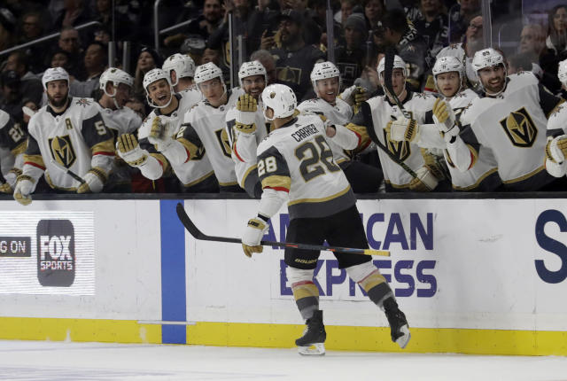 Vegas Golden Knights' William Carrier (28) celebrates with teammates after scoring against the Los Angeles Kings during the first period of an NHL hockey game Saturday, Dec. 29, 2018, in Los Angeles. (AP Photo/Marcio Jose Sanchez)