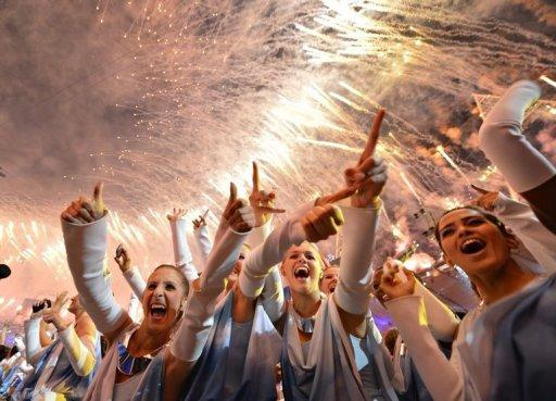 Performers celebrate at the end of the closing ceremony