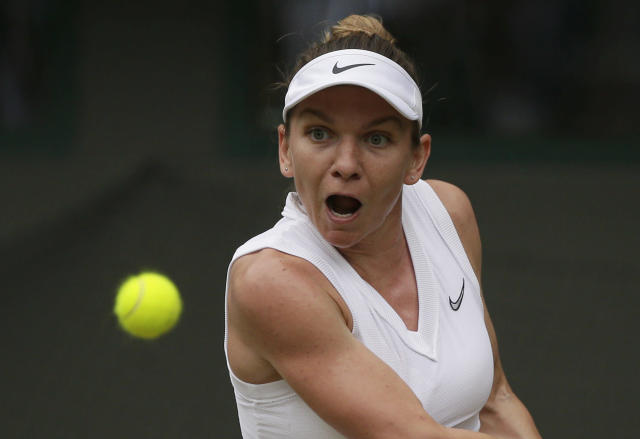 Romania's Simona Halep returns the ball to China's Shuai Zhang during a women's quarterfinal match on day eight of the Wimbledon Tennis Championships in London, Tuesday, July 9, 2019. (AP Photo/Tim Ireland)