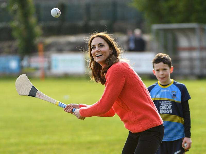 Galway , Ireland - 5 March 2020; Catherine, Duchess of Cambridge makes an attempt to hit a sliothar with a hurley during an engagement at Salthill Knocknacarra GAA Club in Galway during day three of her visit to Ireland. (Photo By Sam Barnes/Sportsfile via Getty Images)