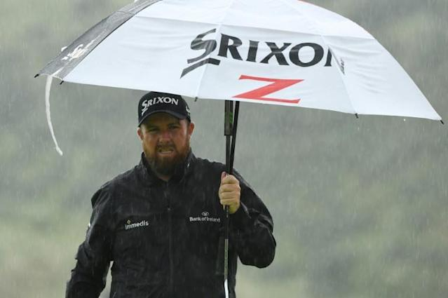 Lowry made it a stroll in the rain with an excellent final round (AFP Photo/Glyn KIRK)