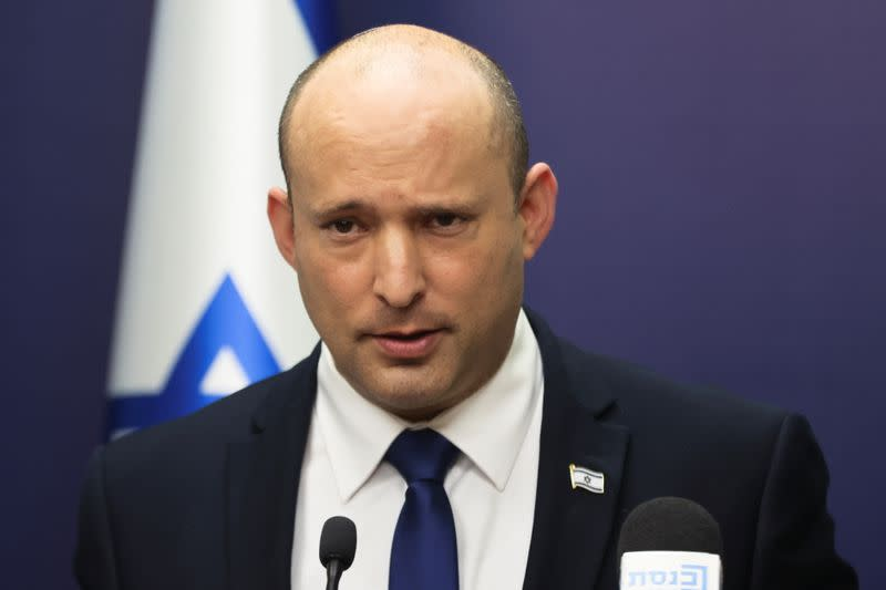 Israeli Prime Minister Bennett speaks during his party faction meeting at Israel's parliament in Jerusalem