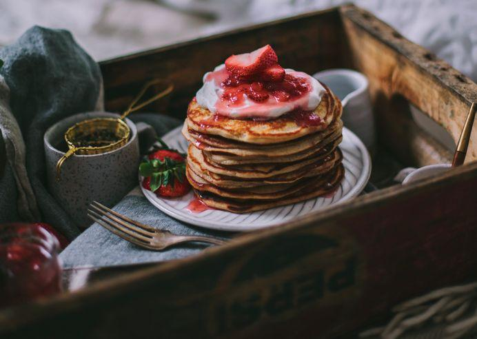 """<strong>Get the&nbsp;<a href=""""http://www.adventures-in-cooking.com/2015/05/goat-cheese-vanilla-bean-pancakes.html"""">Goat Cheese and Mascarpone Vanilla Bean Pancakes with Strawberry Rhubarb Syrup recipe</a>&nbsp;from Adventures in Cooking</strong>"""