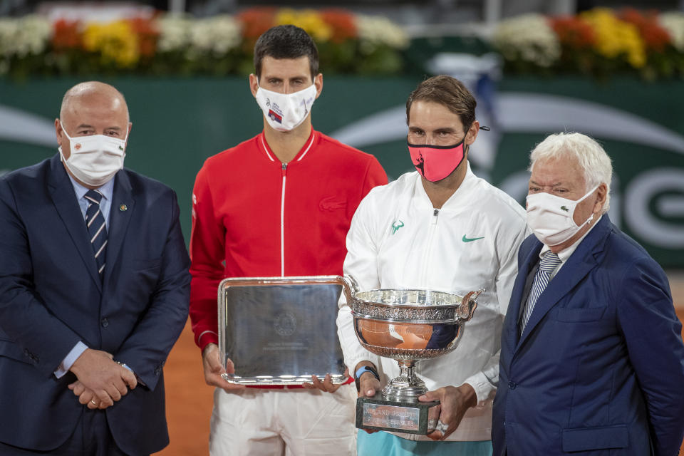 Rafael Nadal poses with the winners trophy after winning the French Open final against Novak Djokovic.