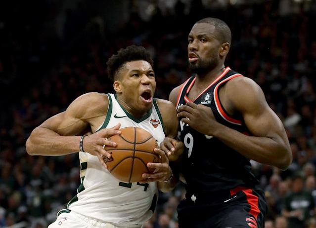 MILWAUKEE, WISCONSIN – MAY 17: Giannis Antetokounmpo #34 of the Milwaukee Bucks dribbles the ball while being guarded by Serge Ibaka #9 of the Toronto Raptors in the third quarter during Game Two of the Eastern Conference Finals of the 2019 NBA Playoffs at the Fiserv Forum on May 17, 2019 in Milwaukee, Wisconsin. NOTE TO USER: User expressly acknowledges and agrees that, by downloading and or using this photograph, User is consenting to the terms and conditions of the Getty Images License Agreement. (Photo by Jonathan Daniel/Getty Images)