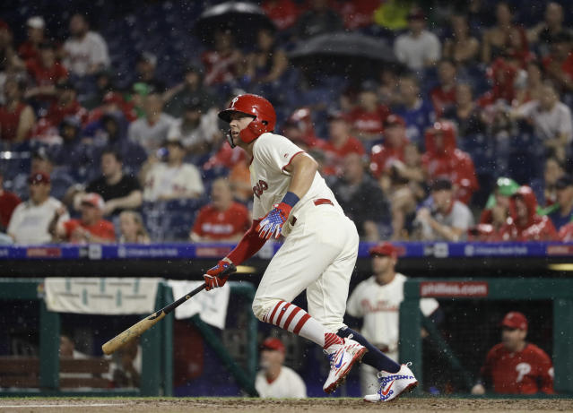 Philadelphia Phillies' Rhys Hoskins follows through after hitting a two-run double off Baltimore Orioles starting pitcher Alex Cobb during the third inning of a baseball game, Tuesday, July 3, 2018, in Philadelphia. (AP Photo/Matt Slocum)