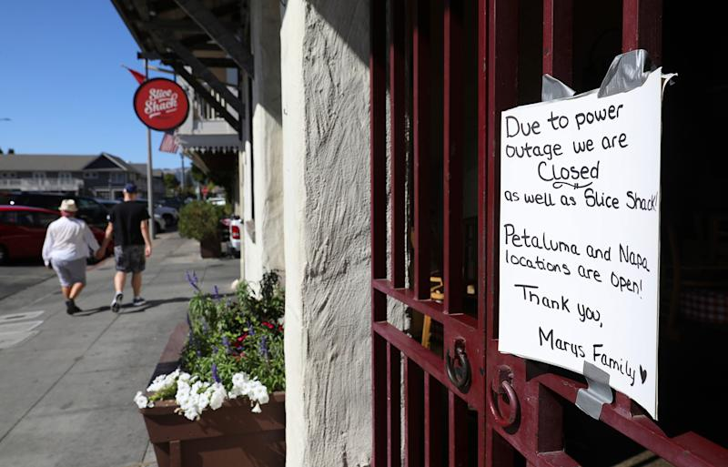 A sign at Mary's Pizza Shack informs customers of the eatery's closure because of a PG&E power shutdown in Sonoma, Calif., on Oct. 9, 2019.