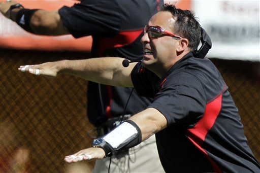 Nebraska defensive coordinator John Papuchis signals his players in the first half of an NCAA college football game against Arkansas State in Lincoln, Neb., Saturday, Sept. 15, 2012. Papuchis took over coaching the game after head coach Bo Pelini was taken to hospital at halftime. (AP Photo/Nati Harnik)