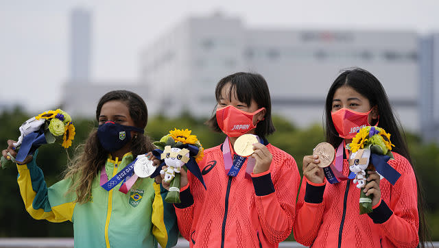 Japan's Momiji Nishiya (Centre), Rayssa Leal of Brazil and Japan's Funa Nakayama, all teenagers, clinched gold, silver and bronze respectively in the women's street skateboarding finals. AP