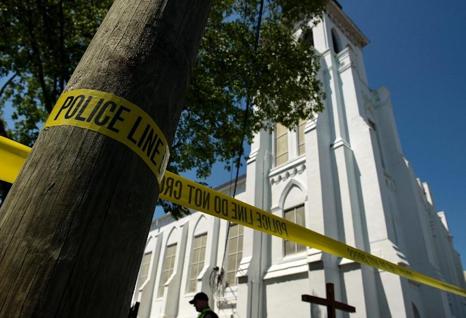 Police tape outside the Emanuel AME Church, after a mass shooting there the night before in Charleston, South Carolina, on June 18, 2015 (AFP Photo/Brendan Smialowski)