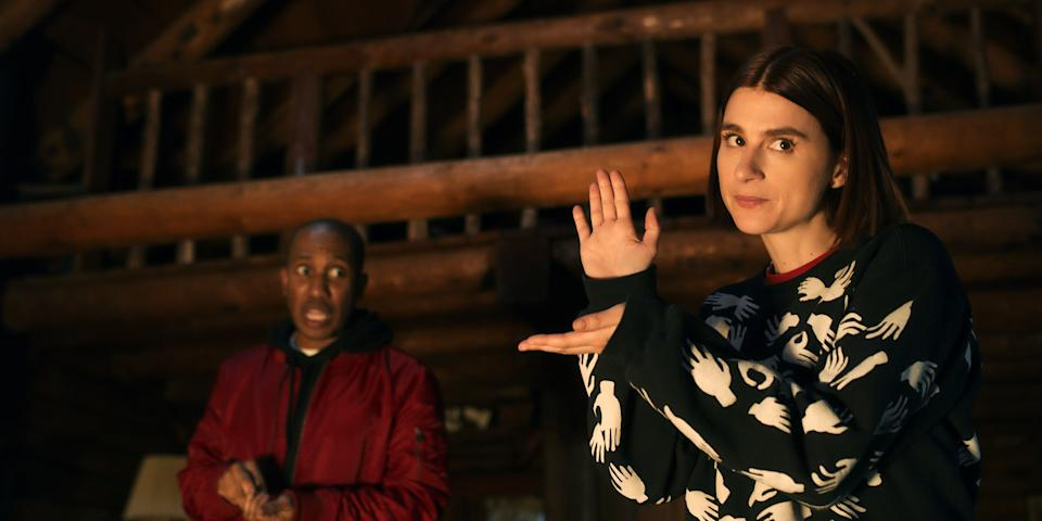 """The meta horror comedy """"Scare Me"""" stars Aya Cash (right, with Chris Redd) as a master teller of frightful tales stuck with a fellow writer in a Catskills cabin that brings their stories to freaky life."""