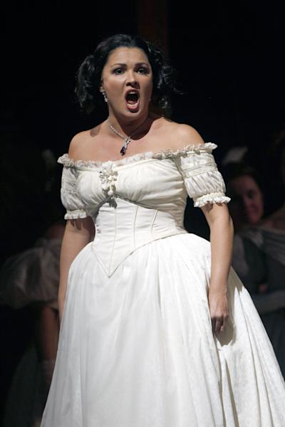 "In this Sept. 20, 2012 photo, Anna Netrebko performs as Adina during the final dress rehearsal of Gaetano Donizetti's ""L'Elisir d'Amore"" at the Metropolitan Opera in New York. That most endearing of all comedies, Donizetti's ""L'Elisir d'Amore,"" opened the Metropolitan Opera season on Monday, Sept. 24 in a modest new production made memorable by an outstanding cast. (AP Photo/Mary Altaffer)"