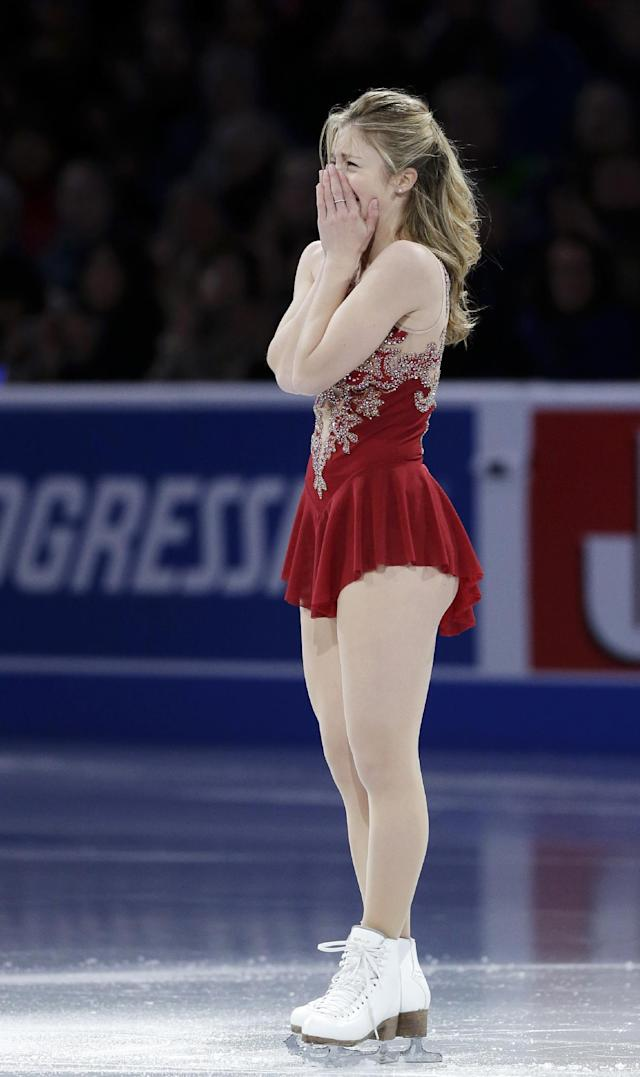 Ashley Wagner becomes emotional at mid-ice after her performance during the skating spectacular after the U.S. Figure Skating Championships in Boston, Sunday, Jan. 12, 2014. Women's third finisher Mirai Nagasu, the only one of the top four finishers with Olympic experience, was bumped in favor of Wagner when U.S. Figure Skating announced the selections earlier Sunday. (AP Photo/Steven Senne)