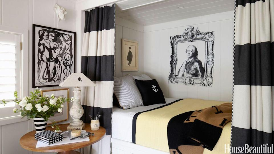 <p>Forget a California king—this cozy nook bedroom by Stephen Shubel proves that smaller can be better, especially if the bed in question is surrounded by chic striped curtains. </p>