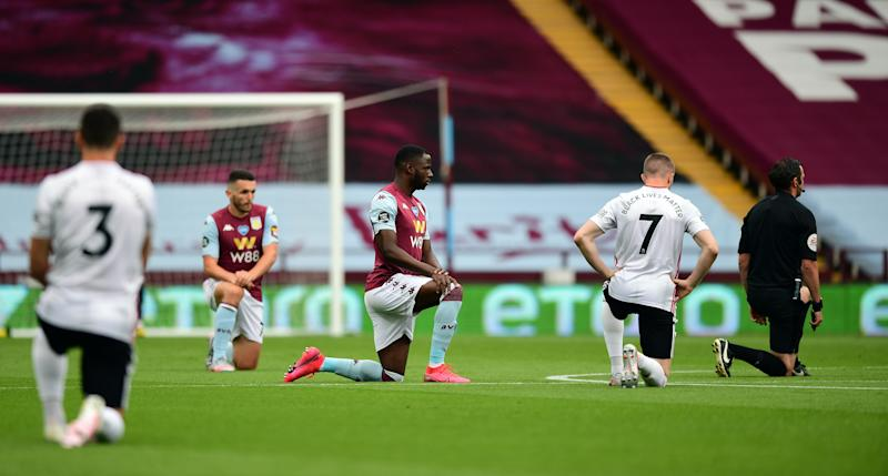 Players and officials take a knee on Premier League's return at Villa Park