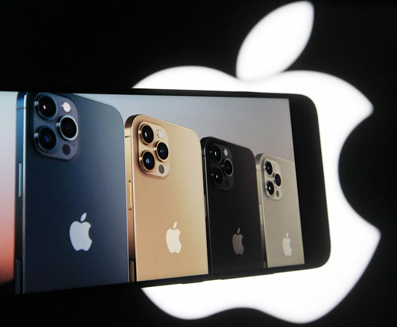 UKRAINE - 2020/10/14: In this photo illustration a screenshot from Apple's launch promotional material of the New iPhone12 Pro seen displayed on a mobile phone screen with an Apple logo in the background. (Photo Illustration by Pavlo Gonchar/SOPA Images/LightRocket via Getty Images)