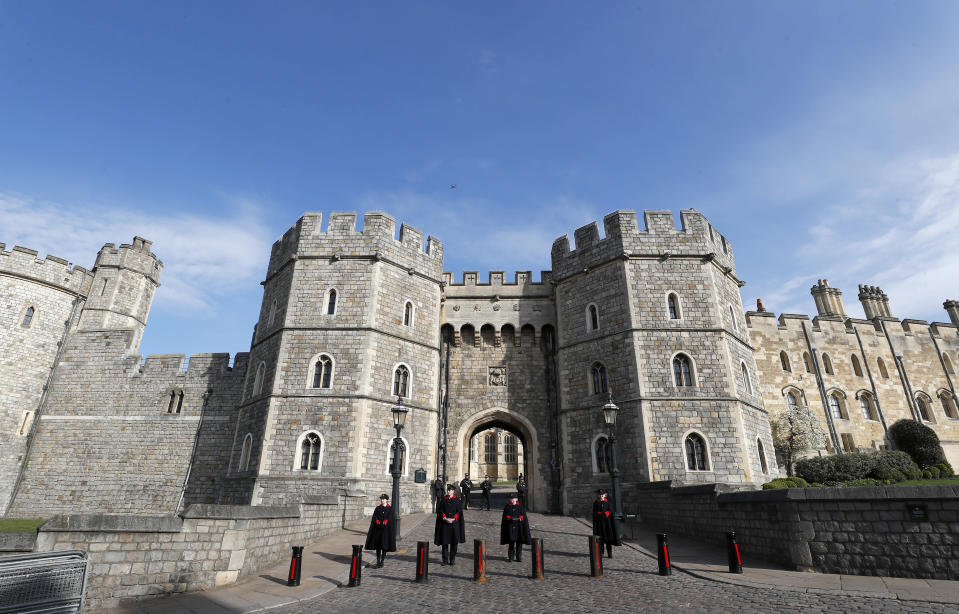 Guards stand at the entrance to Windsor Castle after the death of Britain's Prince Philip in Windsor, Sunday, April 11, 2021. Britain's Prince Philip, the irascible and tough-minded husband of Queen Elizabeth II who spent more than seven decades supporting his wife in a role that mostly defined his life, died on Friday. (AP Photo/Frank Augstein)