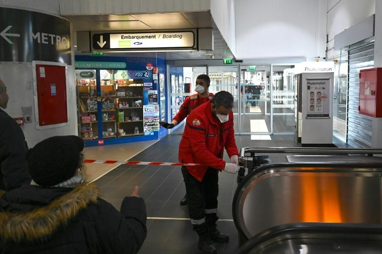 Security personnel after sealing an area at the Lyon Perrache train and bus station in France, after the blocking of a bus arriving from Milan, Italy and suspected of carrying the new coronavirus