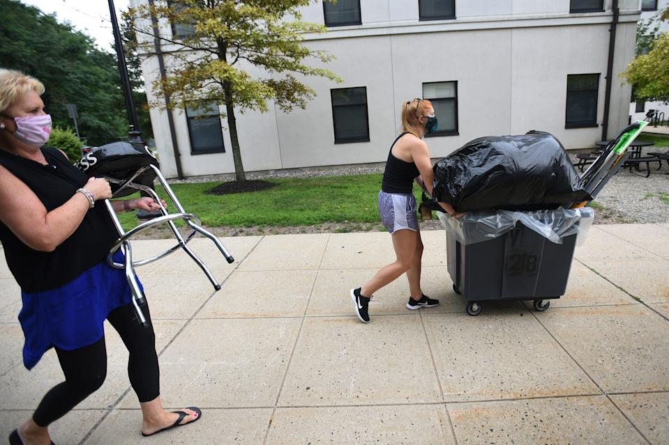 Amy Horensky of Lebanon, NJ., whose major is in Dance Education, pushes her stuff in a cart helped by her mother Patti as she moves into Willams Hall at Montclair State University in Montclair on 08/13/20.