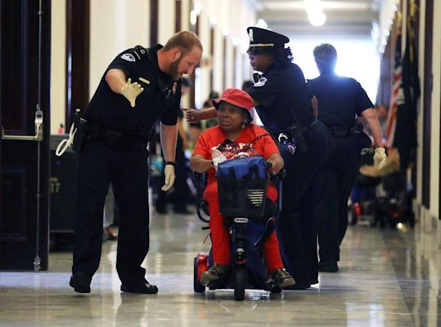 U.S. Capitol Police remove protesters from in front of the office of Senate Majority Leader Mitch McConnell. (Photo: Mark Wilson/Getty Images)