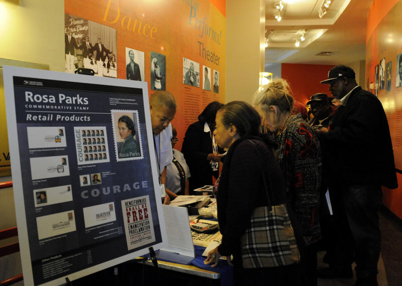 People line up for stamps at the unveiling of the Rosa Parksí 100th birthday commemorative postage stamp at the Museum of African American History in Detroit on Monday,Feb. 4, 2013, at the unveiling of the Rosa Parksí 100th birthday commemorative postage stamp at the Museum of African American History in Detroit on Monday, Feb. 4, 2013. The Rosa Parks Forever Stamp went on sale Monday and was part of a series of events scheduled throughout the day to honor her. AP Photo/The Detroit News, David Coates) DETROIT FREE PRESS OUT, HUFFINGTON POST OUT