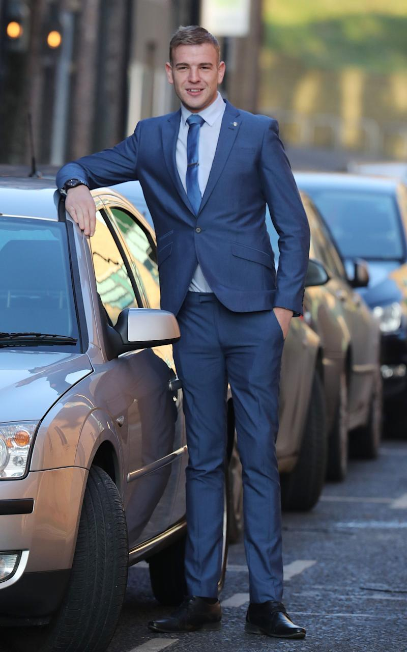 He previously claimed he was sitting in the car, but it looked like he was standing because he is very tall - Credit: PA