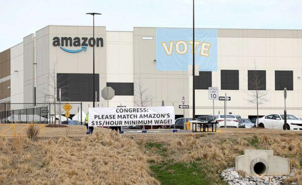 PHOTO: Banners hang at the Amazon facility before worker vote on whether to unionize, in Bessemer, Alabama, March 5, 2021. (Dustin Chambers/Reuters)