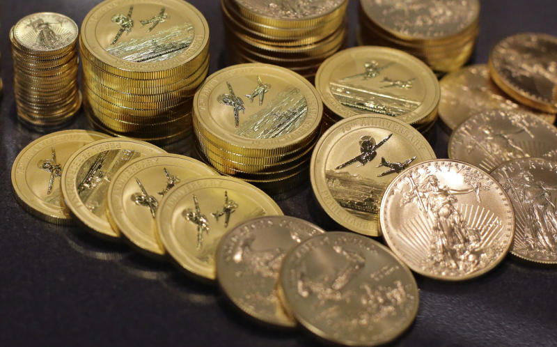 In this July 1, 2016, photo, gold coins lie on display at the office of Philip Diehl in Austin, Texas. Safety is a big draw since the shocking British vote to leave the European Union, sending gold prices soaring. (AP Photo/Eric Gay)