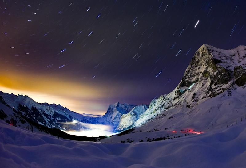 This long night exposure photo taken on late January 13, 2010 in Wengen shows Swiss famous north face of the Eiger mountain overlooking the ressort of Grindelwald located in the Bernese Alps