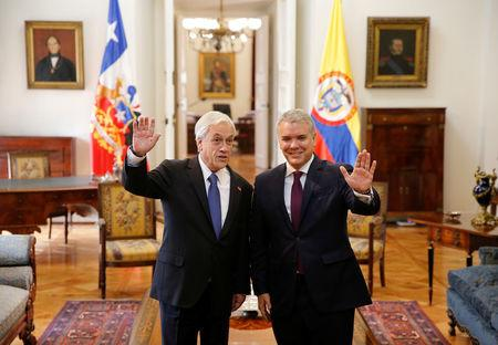 Colombian President Ivan Duque and his Chilean counterpart Sebastian Pinera pose during a meeting at La Moneda Palace in Santiago
