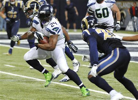 Oct 28, 2013; St. Louis, MO, USA; Seattle Seahawks running back Marshawn Lynch (24) runs the ball against the St. Louis Rams during the second half at Edward Jones Dome. The Seahawks defeat the Rams 14-9. Mandatory Credit: Jasen Vinlove-USA TODAY Sports
