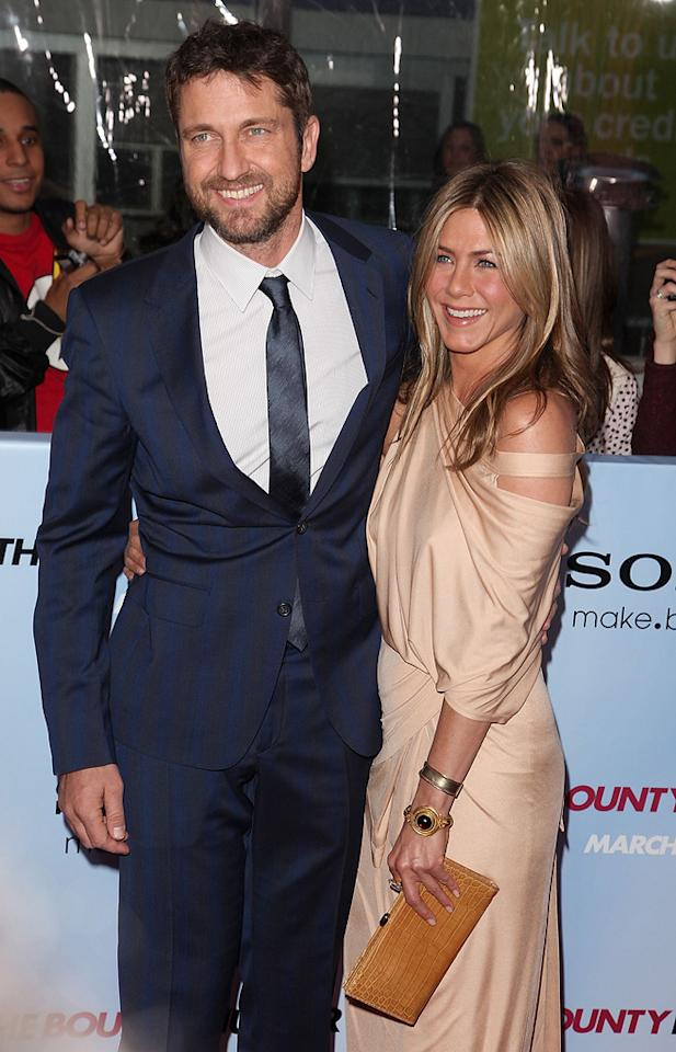 "<a href=""http://movies.yahoo.com/movie/contributor/1803248911"">Gerard Butler</a> and <a href=""http://movies.yahoo.com/movie/contributor/1800021397"">Jennifer Aniston</a> at the New York City premiere of <a href=""http://movies.yahoo.com/movie/1810129411/info"">The Bounty Hunter</a> - 03/16/2010"