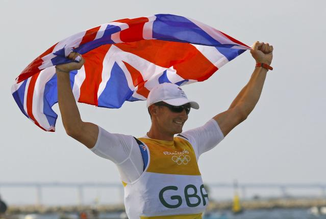 2016 Rio Olympics - Sailing - Final - Men's One Person Dinghy (Heavyweight) - Finn - Medal Race - Marina de Gloria - Rio de Janeiro, Brazil - 16/08/2016. Giles Scott (GBR) of Britain celebrates gold medal. REUTERS/Brian Snyder FOR EDITORIAL USE ONLY. NOT FOR SALE FOR MARKETING OR ADVERTISING CAMPAIGNS.