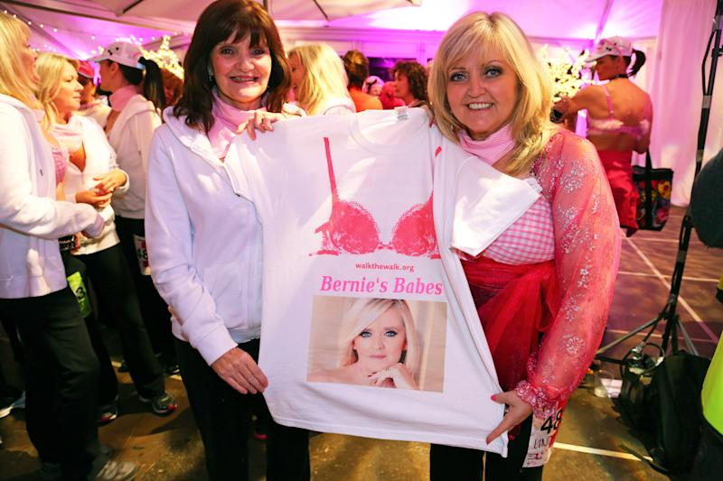 Linda and Anne doing a Walk the Walk Moonwalk charity walk with a T shirt showing their sister Bernie who died of breast cancer in 2013 (Photo: Paul Brown/Shutterstock)